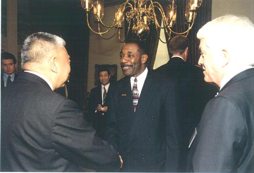 Dr. Toby Malichi; then, board member - U.S. Chamber of Commerce; discussing Trade issues and the Chinese Hand-Over with Tung Chee Hwa, Chief Executive - Hong Kong Special Administrative Region (HKSAR) and Tom Donohue, CEO & President - U. S. Chamber of Commerce